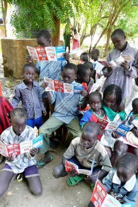 Children reading leaflets in Turkana, Kenya