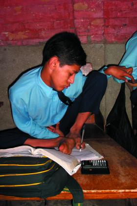 Young boy writing, Nepal