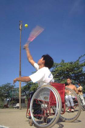 Man playing wheelchair tennis, Cambodia